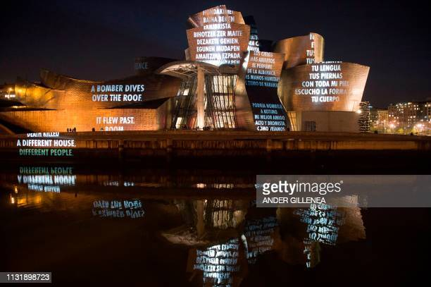 US artist Jenny Holzer's projection mapping creation entitled 'For Bilbao' is projected on the Guggenheim Bilbao Museum's facade as part of the...