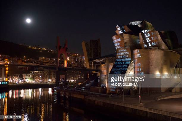 US artist Jenny Holzer's projection mapping creation entitled For Bilbao is projected on the Guggenheim Bilbao Museum's facade as part of the Jenny...