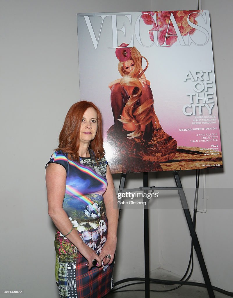Artist J.K. Russ stands next to an image of her Vegas Magazine cover during Vegas Magazine's 'Art Of The City' issue celebration at The Cosmopolitan of Las Vegas on July 25, 2015 in Las Vegas, Nevada.
