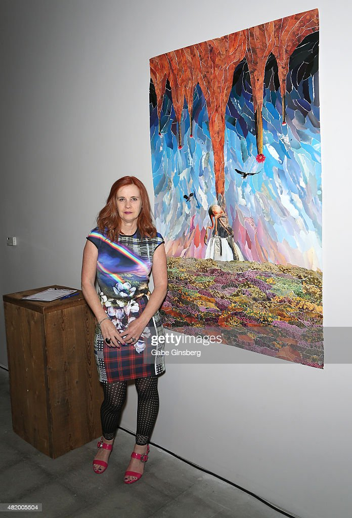 Artist J.K. Russ stands next to her collage titled 'The Source' during Vegas Magazine's 'Art Of The City' issue celebration at The Cosmopolitan of Las Vegas on July 25, 2015 in Las Vegas, Nevada.