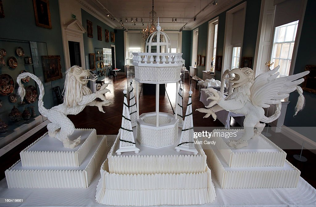 Artist Joan Sallas' 1.5-metre-high folded linen table fountain is displayed as part of a new exhibition 'Folded Beauty: Masterpieces in Linen', which is opening at the Holbourne Museum on January 31, 2013 in Bath, England. The exhibition of the lost art of linen folding, examples of which would once have graced the dining tables of Kings and Emperors in seventeenth century Europe, will include animals, flowers and even miniature buildings and fountains all made from intricately starched and folded linen. This is the first UK exhibition by the world's leading authority on historic linen folding who has previously exhibited his work across Europe and the USA.