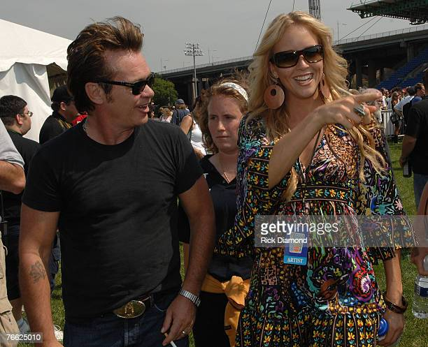 Artist John Mellencamp and Artist Pauline Reese Backstage at Farm Aid 2007 at ICAHN Stadium on Randall's Island NY September 92007