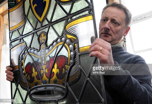Artist John Reyntiens works on the stained glass window he has designed for the Queen's Diamond Jubilee celebrations, February 10, 2012 in London,...