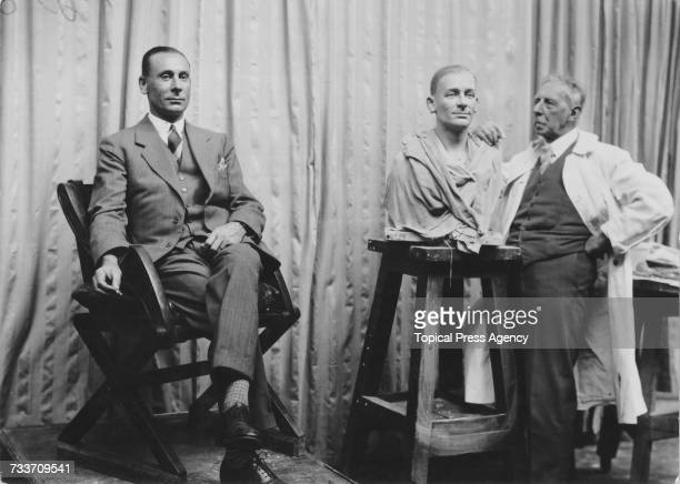 Artist John Theodore Tussaud sculpts a bust of English cricketer Jack Hobbs at Madame Tussauds wax museum in London September 1930
