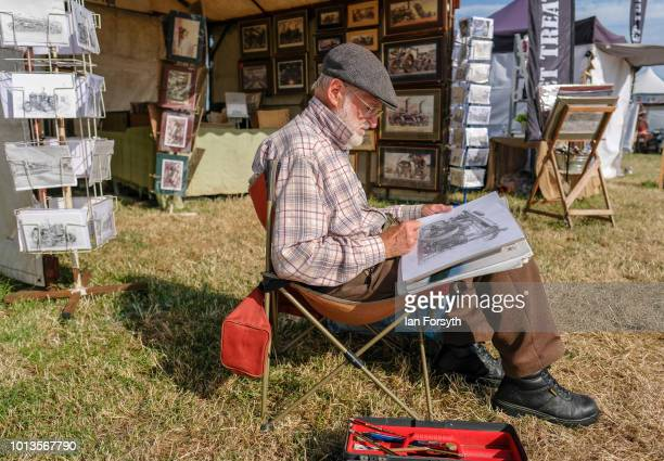Artist John Winston from Weardale sketches steam locomotives as he sits outside his stall during the final day of the Whitby Traction Engine Rally on...