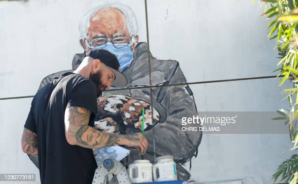 Artist Jonas Never paints a mural of Senator Bernie Sanders in Culver City, California on January 24, 2021. - Standing out in a crowd of glamorously...
