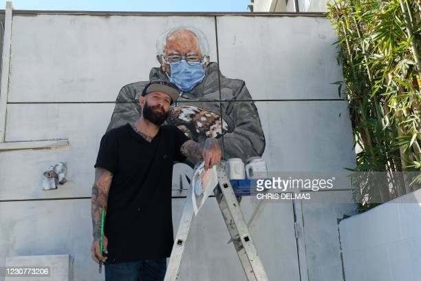 Artist Jonas Never paints a mural of Senator Bernie Sanders in Culver City, California on January 24, 2021. / RESTRICTED TO EDITORIAL USE - MANDATORY...