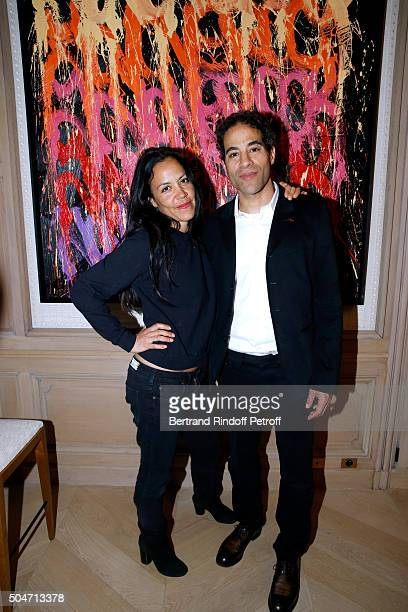 Artist JonOne and his wife Mai Lucas Perello attend the Guerlain collaboration with Graffiti Artist JonOne Color Flows Exhibition Launch's Cocktail...