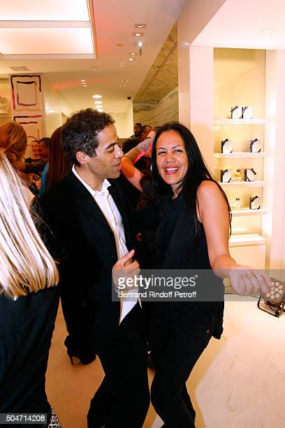 Artist JonOne and his wife Mai Lucas Perello dance during the Guerlain collaboration with Graffiti Artist JonOne Color Flows Exhibition Launch's...