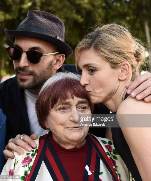 Artist JR, director Agnes Varda and actress Julie Gayet attend the 90th Academy Awards French Nominees Reception hosted by the Consul General of...