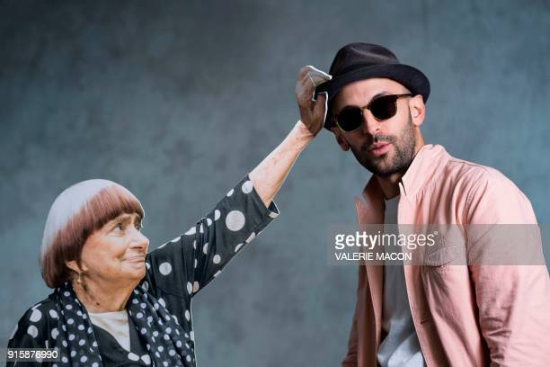 TOPSHOT Artist JR poses for portraits with a cardboard cut out of Director Agnes Varada during the Academy Awards annual nominees luncheon for the...