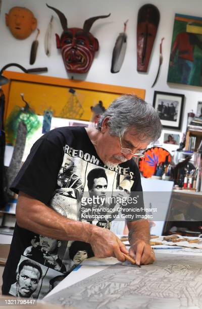 Artist Juan R. Fuentes works on a linoleum print of japanese farmworkers in his studio on Thursday, June 18 in San Francisco, Calif. It will become a...