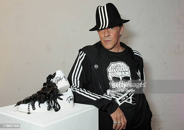 Artist Judy Blame poses with his design at a private view of the Platform Six exhibition with adidas Originals Stan Smith auction in support of...