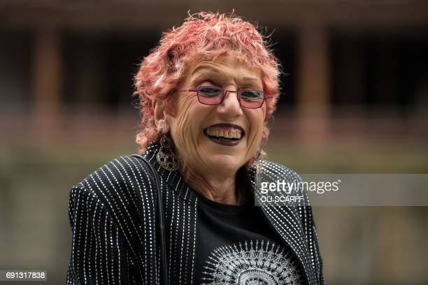 US artist Judy Chicago poses near her mural entitled 'Fixing a Hole' which depicts the Beatles and was inspired by their song of the same name from...