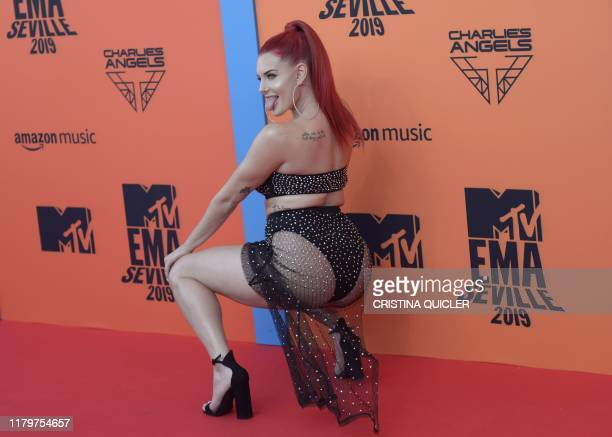 US artist Justina Valentine poses on the red carpet upon arrival to the MTV Europe Music Awards at the FIBES Conference and Exhibition Centre of...