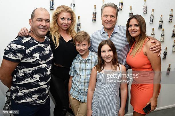 Artist Kadir Lopez Christina Moonan and Tim Moonan attend Kadir Lopez's Art Show on August 12 2016 in West Hollywood California