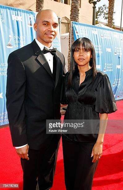 Artist Kadir Nelson and his wife arrive at the 38th annual NAACP Image Awards held at the Shrine Auditorium on March 2 2007 in Los Angeles California