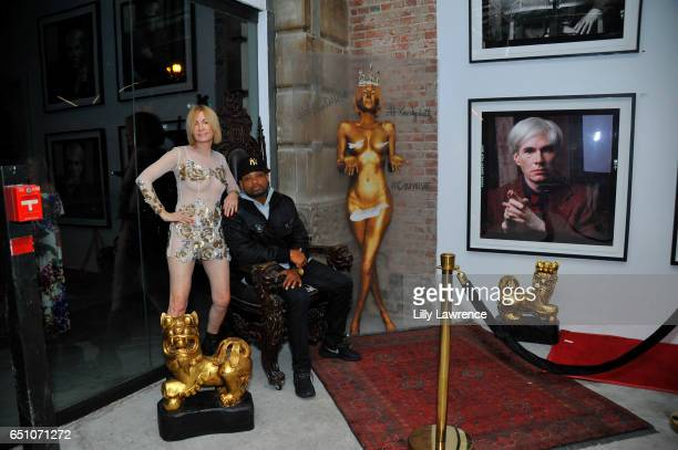 Artist Karen Bystedt and actor Chico Benymon attend Karen Bystedt's 'Kings And Queens' exhibition on March 9 2017 in Los Angeles California