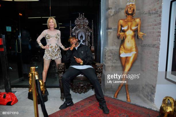 Artist Karen Bystedt and actor Chico Benymon attend Karen Bystedt's Kings And Queens exhibition on March 9 2017 in Los Angeles California