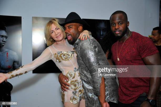 Artist Karen Bystedt stylist Melvin Styles and professional football player Jerry Housey attend Karen Bystedt's 'Kings And Queens' exhibition on...