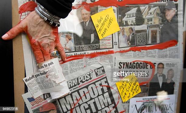 Artist Karen Dweck displays a collage of newspaper clippings on Bernard Madoff founder of Bernard L Madoff Investment Securities LLC while Madoff...