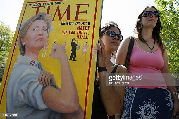 Artist Karli Steffy holds a painting she made of Democratic presidential hopeful New York Senator Hillary Rodham Clinton at a Clinton campaign event...