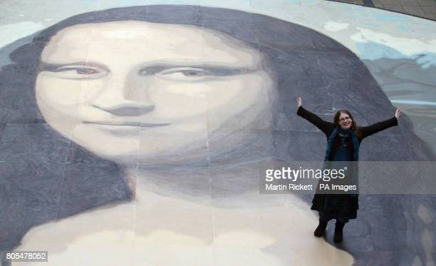 Artist Katy Webster stands on her attempt at the worlds biggest copy of the Mona Lisa during a photocall for it's unveiling at the Eagles Meadow...