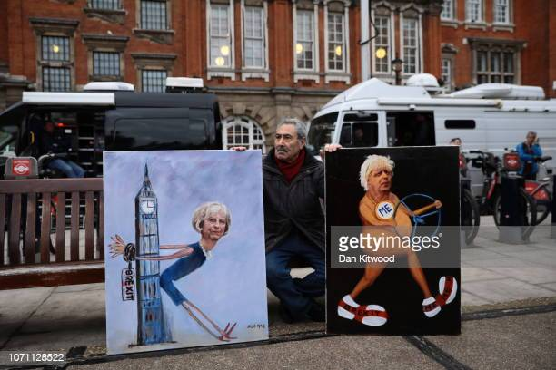 Artist Kaya Mar displays paintings depicting Theresa May and Boris Johnson outside the Houses of Parliament in Westminster on December 10 2018 in...