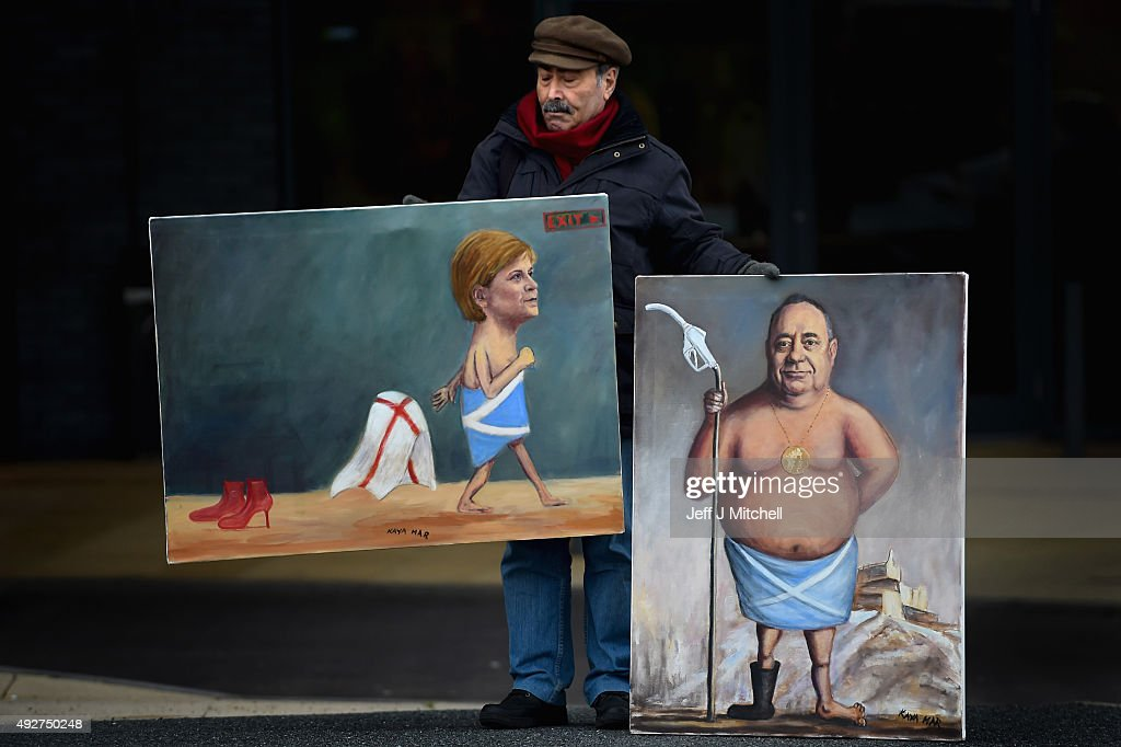 Artist Kaya Mar holds his paintings of First Minister Nicola Sturgeon and Alex Salmond MP outside the 81st SNP conference at the Aberdeen Exhibition and Conference centre on October 15, 2015 in Aberdeen, Scotland. Nicola Sturgeon will use her opening speech at the SNP conference to call on people who rejected independence in the referendum to vote for her party in next year's Holyrood election.