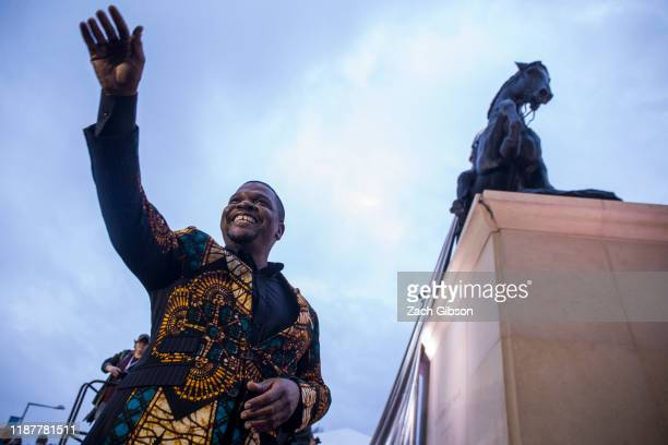Artist Kehinde Wiley acknowledges the crowd during an unveiling ceremony for his statue, Rumors of War, at the Virginia Museum of Fine Arts on...