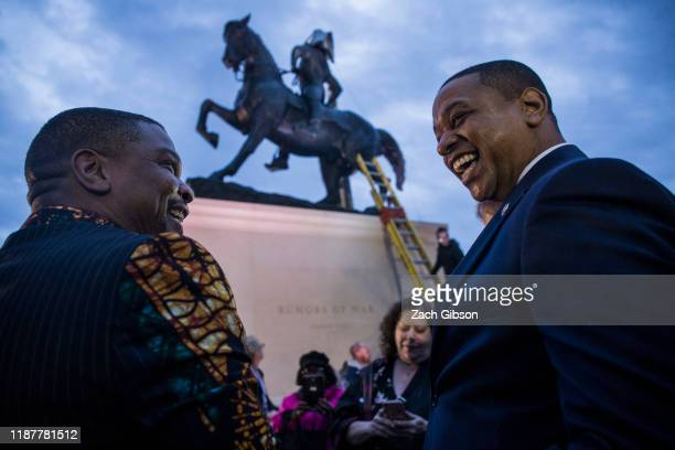 Artist Kehinde Wiley speaks to Viriginia Lt. Gov. Justin Fairfax during an unveiling ceremony for Wiley's statue, Rumors of War, at the Virginia...