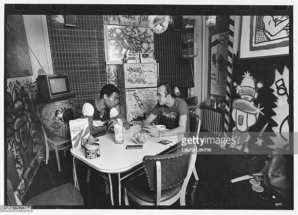 Artist Keith Haring in his apartment with boyfriend Juan Dubose