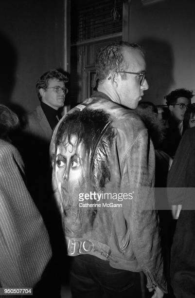 Artist Keith Haring wearing a jacket with a painting of Michael Jackson on the back at the opening of fashion designer Stephen Sprouse's store at 99...