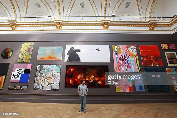 Artist Keith Tyson stands in front of his painting entitled 'Deep Impact' on display in the Royal Academy of Arts' Summer Exhibition on June 2 2011...