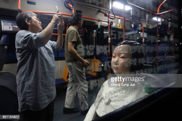 Artist Kim Eunsung and Kim Seokyung who have installed comfort woman statue look around in a bus ahead of the 72nd Independence Day on August 14 2017...