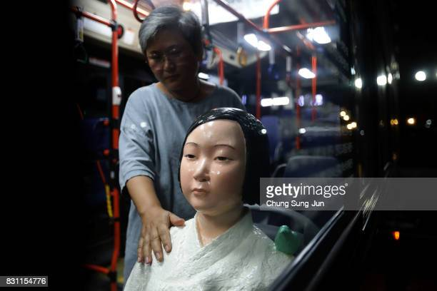 Artist Kim Seokyung who have installed comfort woman statue touchs a statue in a bus ahead of the 72nd Independence Day on August 14 2017 in Seoul...