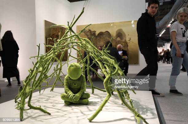 Artist Kim Simonnson's art work is seen during the Armory Show that is the biggest international art fair staged in New York United States on March...