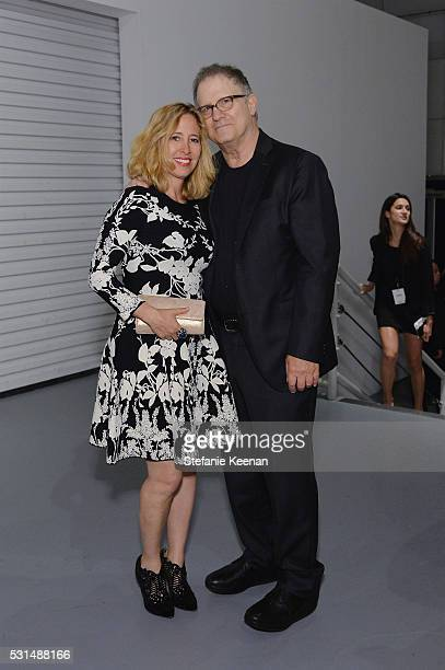 Artist Kimberly Schlain and actor Albert Brooks attend the MOCA Gala 2016 at The Geffen Contemporary at MOCA on May 14 2016 in Los Angeles California