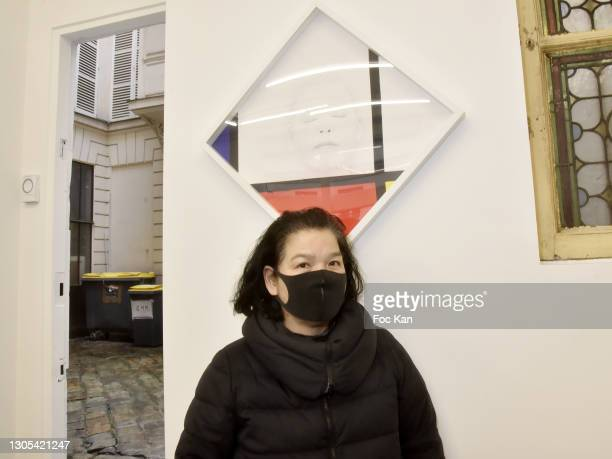 """Artist Kimiko Yoshida poses with his work during """"Ils Ont Dit Oui"""" Exhibition an Amalteo Institute Project Curated by Marc Molk at Galerie Marguerite..."""