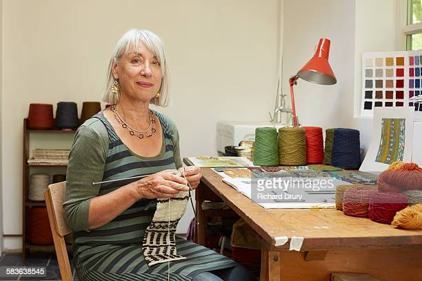 artist knitting in her studio - knitting stock pictures, royalty-free photos & images
