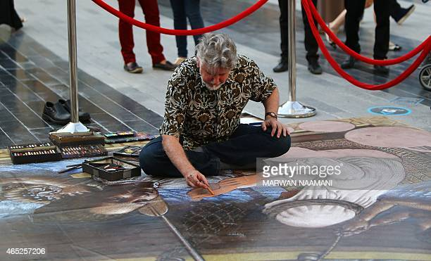 US artist Kurt Wenner works on one of his 3D artwork on March 4 2015 near the Jumeirah Beach Residence in Dubai during the Canvas Festival a...