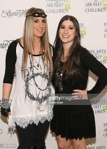 Artist Lauren Moshi and Danielle Moshi attend the 'Lauren Moshi Gallery for Free Arts for Abused Children' event at Lauren Moshi Gallery on December...