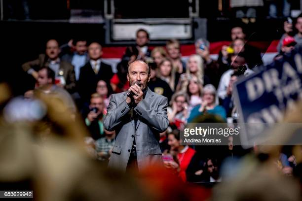 Artist Lee Greenwood sings his song 'God Bless The USA' before a rally held by President Trump on March 15 2017 in Nashville Tennessee During his...