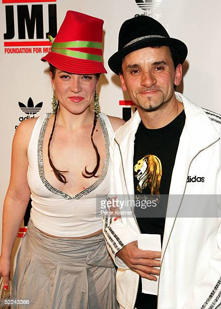 Artist Lee Quinones and date attend the 35th anniversary of the Adidas superstar sneaker honoring the life of Jam Master Jay on February 25 2005 in...