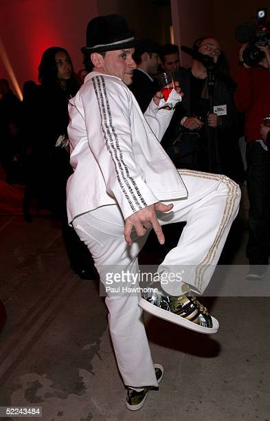 Artist Lee Quinones poses with a pair of Addidas sneakers he designed as he attends the 35th anniversary of the Adidas superstar sneaker honoring the...