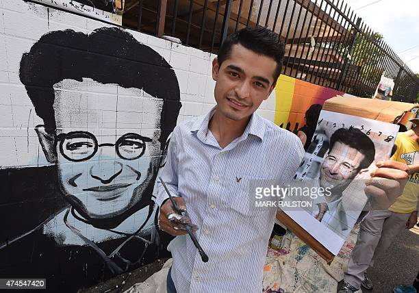 Artist Levi Ponce poses with his Memorial Day mural project of murdered journalist Daniel Pearl near his old neigborhood in Los Angeles California on...
