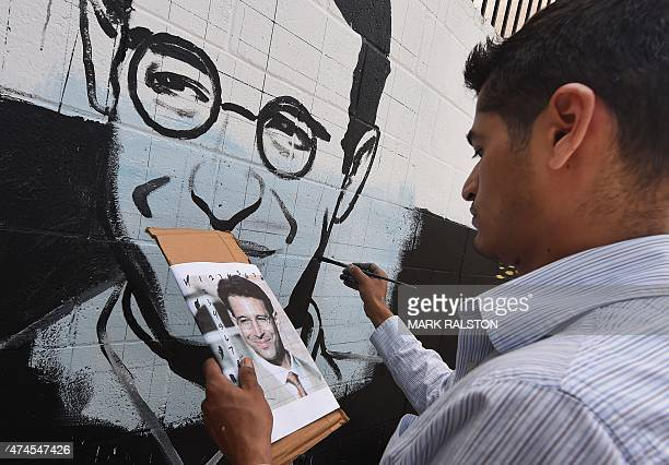 Artist Levi Ponce works on his Memorial Day mural project of murdered journalist Daniel Pearl near his old neigborhood in Los Angeles California on...