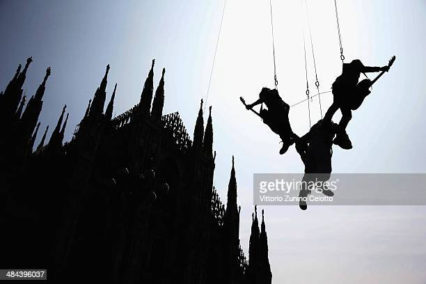 Artist Li Wei and Sonohra perform in Piazza Duomo during the Milan Design Week on April 10 2014 in Milan Italy