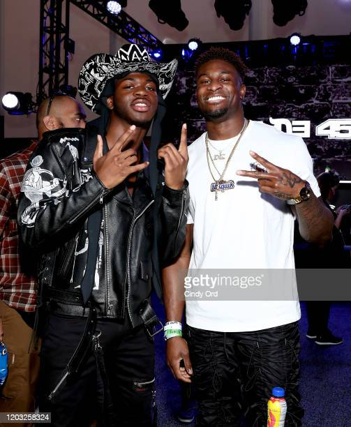 Artist Lil Nas X and NFL player DK Metcalf of the Seattle Seahawks attend day 3 of SiriusXM at Super Bowl LIV on January 31 2020 in Miami Florida