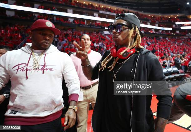 Artist Lil Wayne attends Game Two of the Western Conference Finals of the 2018 NBA Playoffs between the Houston Rockets and the Golden State Warriors...